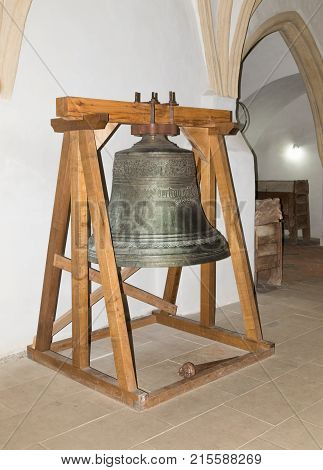Sighisoara Romania October 08 2017 : The bell hang on the stand in the Church of the Deal (St. Nicholas) in the castle in Old City. Sighisoara city in Romania