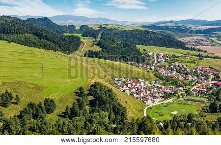 Slovakian Town On Grassy Hillside In Summer