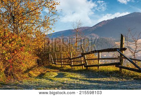 Autumn Rural Scenery With Fence On Hillside