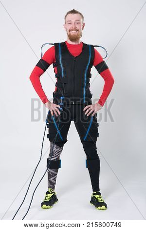 Red-haired Man With A Beard In Electric Muscular Suit For Stimulation
