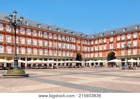 MADRID,SPAIN - AUGUST 5, 2017 : Typical cafes and restaurants at Plaza Mayor, a historic square in Madrid