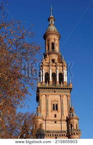 SEVILLE, SPAIN - JANUARY 3, 2012: South tower of Plaza de Espana. Built in 1928, Plaza de Espana is a landmark example of the Renaissance Revival style in Spanish architecture