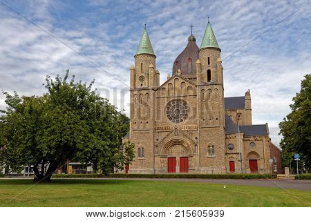 MAASTRICHT, NETHERLANDS - SEPTEMBER 8, 2013: Church Sint-Lambertuskerk in an autumn day. The church was built in 1916 by the project of  Hubert van Groenendael