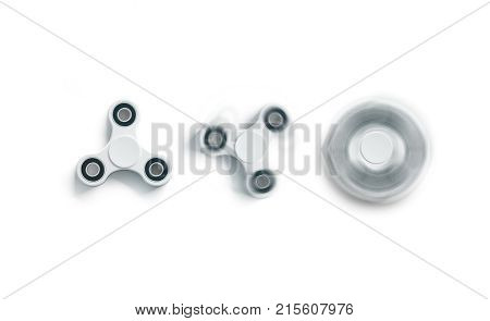 Blank white fidget spinner mockup static and spin top view 3d rendering. Clear spinning toy mock up front design template. Empty stress reliever tri-spinner. Trend device for branding or printing