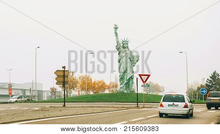 COLMAR FRANCE - NOV 23 2014: Copy of Statue of Liberty made by Auguste Bartholdi at the entrance of Colmar City