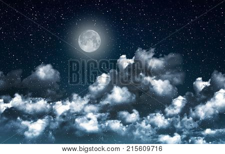 Beautiful magic blue night sky with clouds and fullmoon and stars closeup.