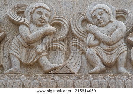 Stone Mural Of Children Playing