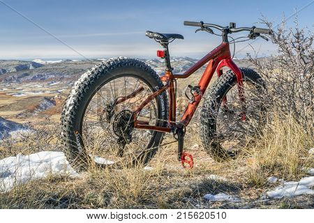 Fort Collins, CO, USA - November 9, 2017: Salsa Mukluk Carbon GX1 Fat Bike (2017 model) on Cheyenne Rim Trail in Red Mountain Open Space, fall scenery.