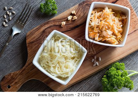Fermented Cabbage And Carrots In Two Square Bowls On A Table, Top View