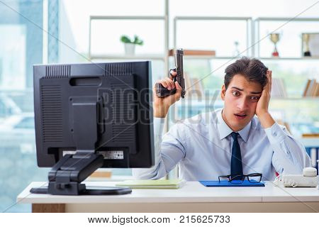 Angry businessman with gun thinking of committing suicide