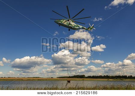 the largest and most load lifting helicopter in the world Halo takes water hovering for fighting forest fires
