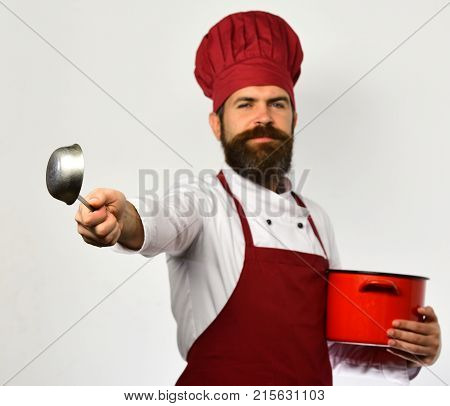 Restaurant Cuisine Concept. Man With Beard Holds Red Pot