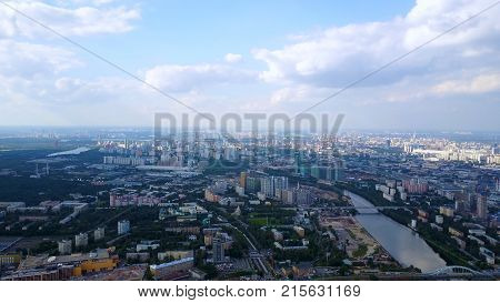 Blue sky with white clouds looks from the tall building. Asia Business concept for real estate and corporate construction - panoramic modern cityscape building bird eye aerial view of skytree under sunrise and morning blue bright