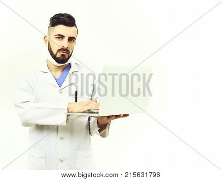 Man With Concentrated Face In White Coat. Doctor With Beard