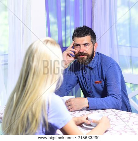 Couple In Love Holds Cups Of Coffee At Table.