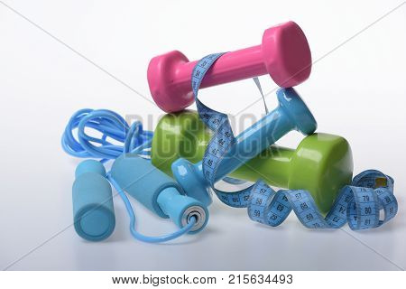 Jump Rope, Barbells And Tape Tied Around Them