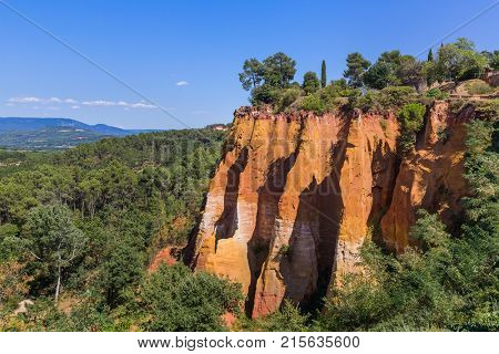 Ochre hills near Roussillon in Provence France - travel and nature background