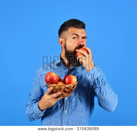 Man With Beard Holds Wicker Bowl With Fruit