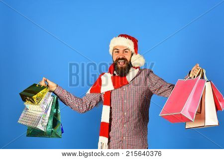 Guy Stands By Christmas Tree And Boxes