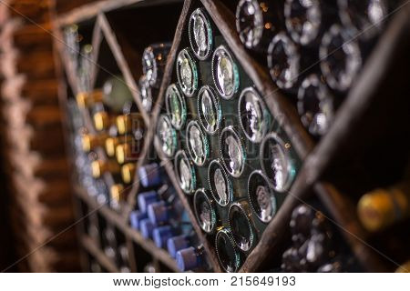 cupboard of bottles of wine winebottles warehouaw cellar design interior