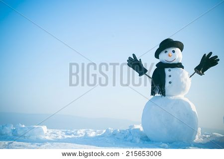 Snowman Gentleman In Winter Black Hat, Scarf And Gloves.