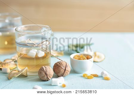 Dried fruits compote. Glass cups with drink from dried fruits, apples, meats, raisins with sugar. A curative and preventive drink for colds.