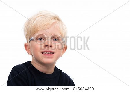 Portrait of a handsome four year old boy wearing glasses and a dark blue jumper on white background