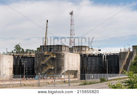 NIAGARA FALLS, CANADA - JUNE 30, 2016: Large metal gates of industrial shipping locks on Welland Canal climbing Niagara Escarpment