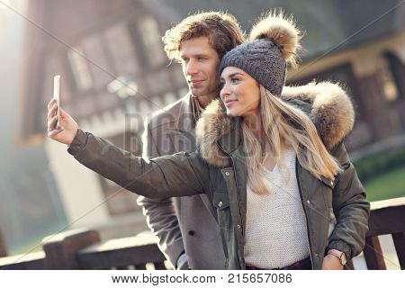 Picture showing happy couple walking outdoors in winter