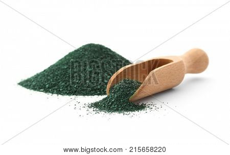 Wooden scoop and pile of spirulina powder on white background