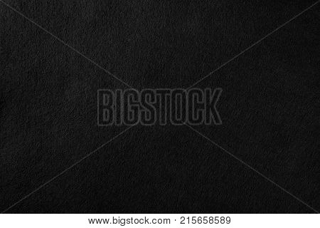 High resolution black texture felt texture fiber natural wool pattern background. Real black felt wool textile texture pattern background felted cloth texture pattern natural abstract background.