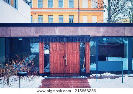 Entrance door into Faculty of Social Sciences at University of Helsinki Finland in winter.