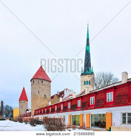 St Olaf Church and defensive walls of the Old town of Tallinn Estonia in winter