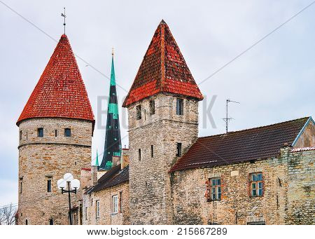 Cityscape with St Olaf Church and defensive walls in the Old town of Tallinn Estonia in winter