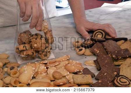 Packaging the assorted cookies.