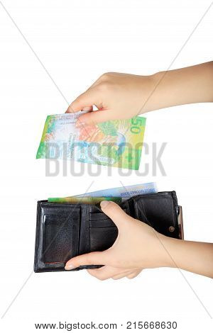 the woman pulls out fifty Swiss francs from her purse isolated on white background