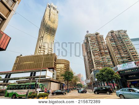 Macau China - March 8 2016: Street view with people and Casino Grand Lisboa in Macao.