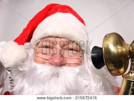 Santa Claus talks on his Golden Candle Stick Telephone. Santa on the Telephone