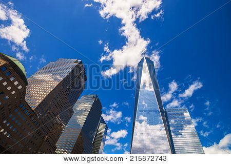 New York USA - April 24 2015: World Trade Center and Freedom Tower in Financial Center in Lower Manhattan New York NYC USA