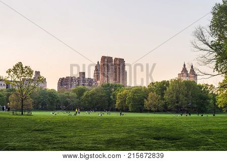 New York USA - May 6 2015: View on Uptown Manhattan skyline in Central Park West. On Upper West Side in New York NYC USA. People nearby