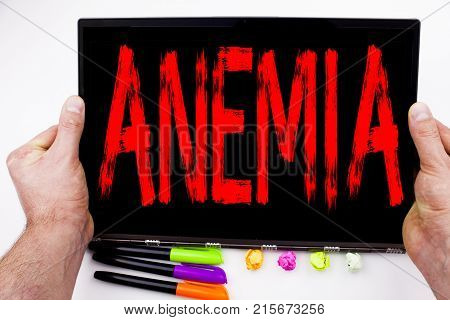Anemia Text Written On Tablet, Computer In The Office With Marker, Pen, Stationery. Business Concept