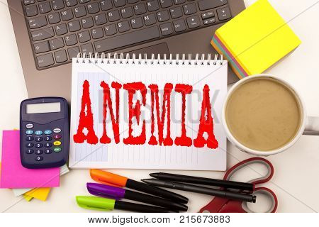 Word Writing Anemia In The Office With Surroundings Such As Laptop, Marker, Pen, Stationery, Coffee.