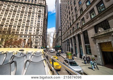 New York USA - April 24 2015: 100 View from excursion bus on Broadway street in Midtown Manhattan New York NYC USA. Tourists on the street.