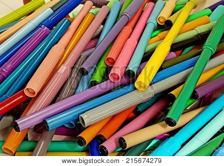 heap of markers, untidy of various colors, background