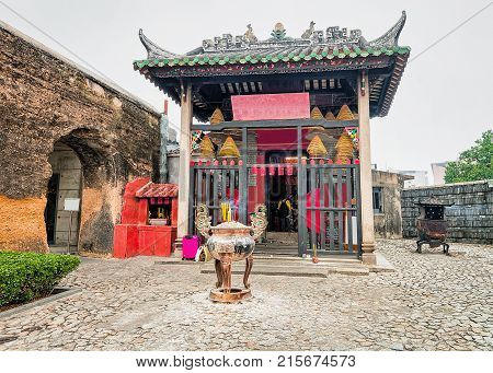 Na Tcha Temple in Historical old city center in Macao China. People on the background