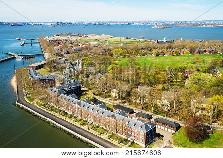 Aerial view from helicopter on Governors Island in Upper New York Bay. New York City NYC USA. Liberty Island is on the background