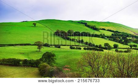 Green hills in Brecon Beacons in South Wales. Brecon Beacons is a chain of mountains in the South of Wales of the United Kingdom UK.