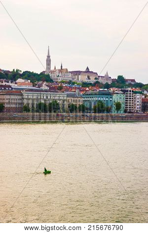 Buda Embankment with Steeple of Matthias Church and the Danube River in Budapest Hungary
