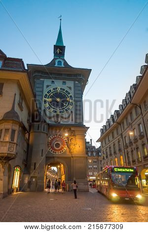 Bern Switzerland - August 21 2013: Zytglogge clock tower on Kramgasse street in old city center of Bern Switzerland. Illuminated late in the evening