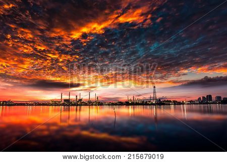 Oil And Gas Industry - Refinery At Sunrise - Factory - Petrochemical Plant With Reflection Over The
